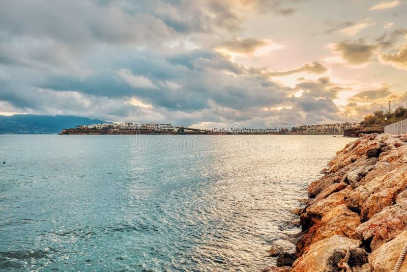 Beautiful landscape scene of a coastline, the sea, rocks and mountain on a cloudy day. In Akyarlar, Turgutreis, Bodrum, Turkey stock photography