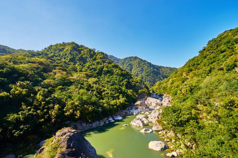 Beautiful landscape scenic of Taiyuan valley or called `Little Heaven`  by the cliffs and green river in Donghe city. Taitung, Taiwan stock photography