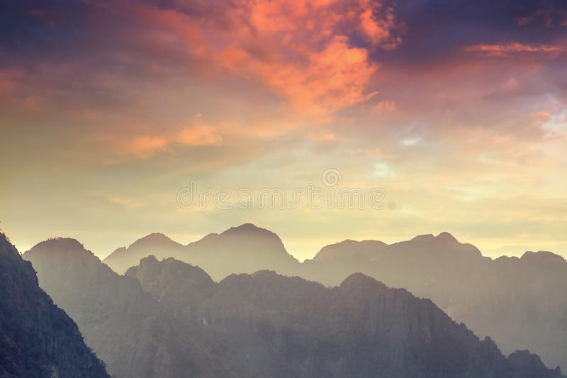 Beautiful landscape. Silhouette of mountains against the sunset. Sky royalty free stock photo