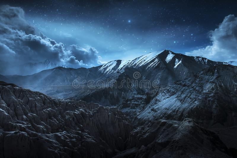 Beautiful landscape snow mountains at night on blue cloud and star background. Leh, Ladakh, IndiaDouble Exposure stock image