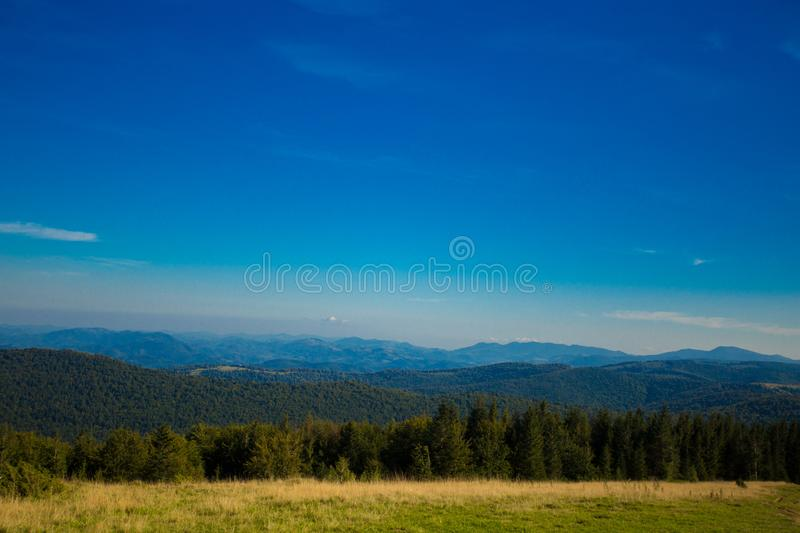 Beautiful landscape of summer mountains with blue sky. Autumn mountain village landscape. Beautiful landscape of summer mountains with blue sky. Autumn mountain royalty free stock photos