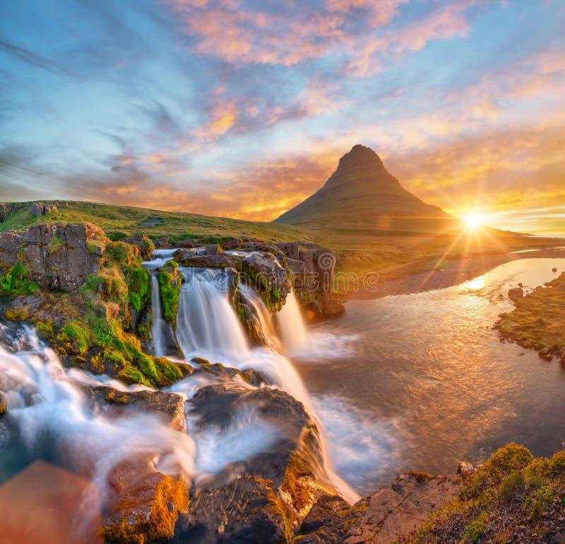 Beautiful landscape with sunrise on Kirkjufellsfoss waterfall and Kirkjufell mountain, Iceland. royalty free stock images