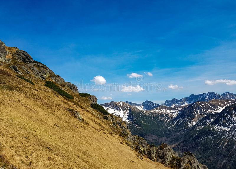 Breathtaking view on Tatra National Park with mountains in sunny spring day with blue sky nearby Zakopane village, Poland. Beautiful landscape of Tatra National royalty free stock images