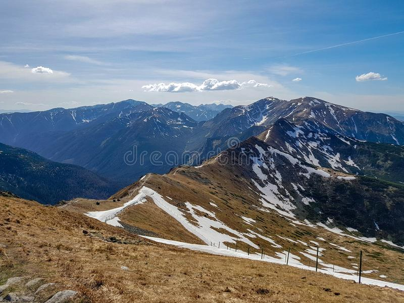 Beautiful landscape of Tatra National Park with mountains in sunny spring day with blue sky nearby Zakopane village, Poland. Stunning view of Tatra Mountains stock photo