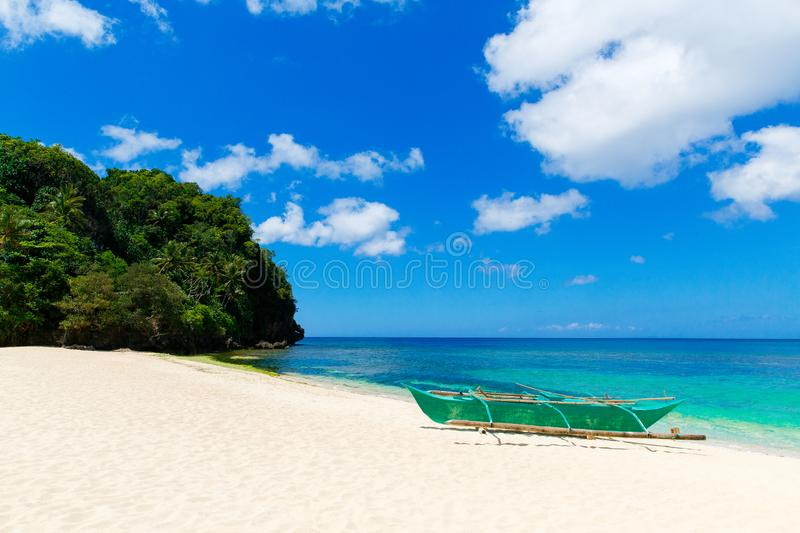 Beautiful landscape of tropical beach boat, sea and white sand. Summer vacation concept.  stock photos