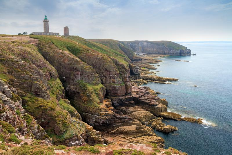 Coastline cliffs at Cap Fréhel. Beautiful landscape view of the coastline at Cap Fréhel in Brittany, France, with its lighthouses and steep cliffs in stock photo