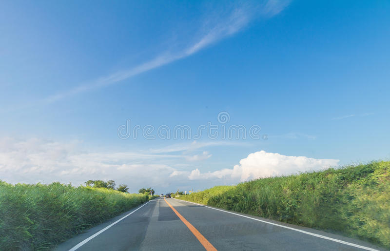 Beautiful landscape view and a country road in spring day with royalty free stock photo