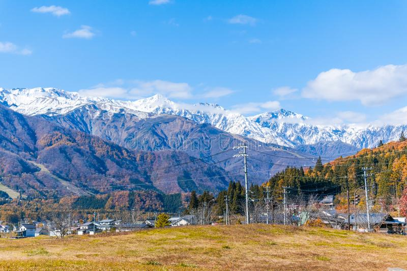 Beautiful landscape view of Hakuba in the winter with snow on the mountain and blue sky background in Nagano Japan stock photography