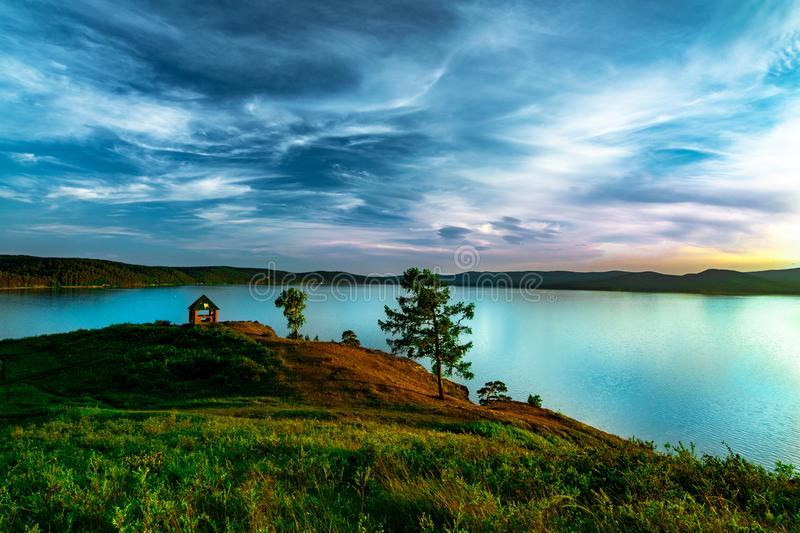 Beautiful landscape view of the mountain lake Turgoyak Russia with summer house. Beautiful landscape view of the mountain lake Turgoyak, Russia with cloudy sky stock image