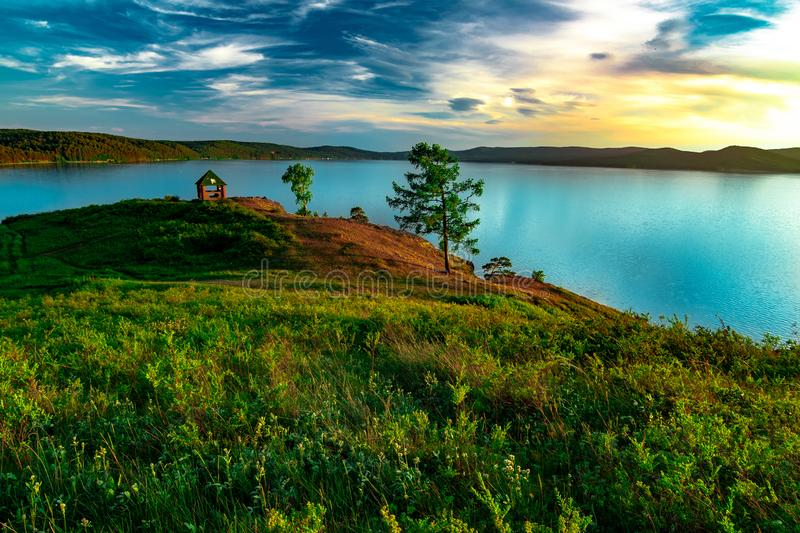 Beautiful landscape view of the mountain lake Turgoyak Russia with summer house. Beautiful landscape view of the mountain lake Turgoyak, Russia with cloudy sky stock photography