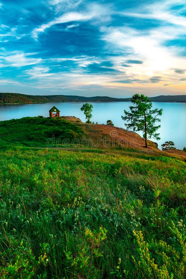Beautiful landscape view of the mountain lake Turgoyak Russia with summer house. Beautiful landscape view of the mountain lake Turgoyak, Russia with cloudy sky stock images