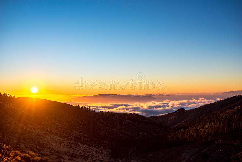 Beautiful landscape view on the sunset. Beautiful landscape view on La Gomera island from Tenerife island above the clouds on the sunset stock photography