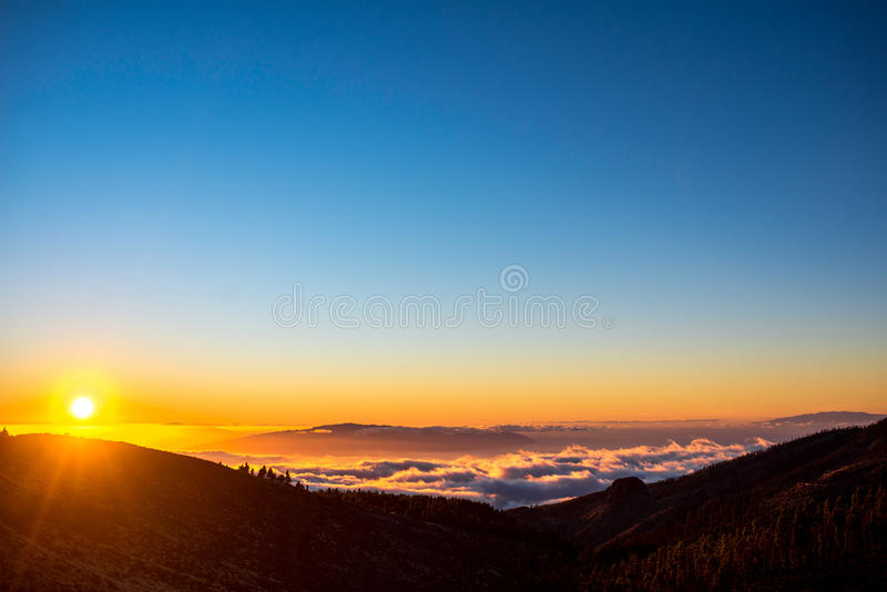 Beautiful landscape view on the sunset. Beautiful landscape view on La Gomera island from Tenerife island above the clouds on the sunset stock photos