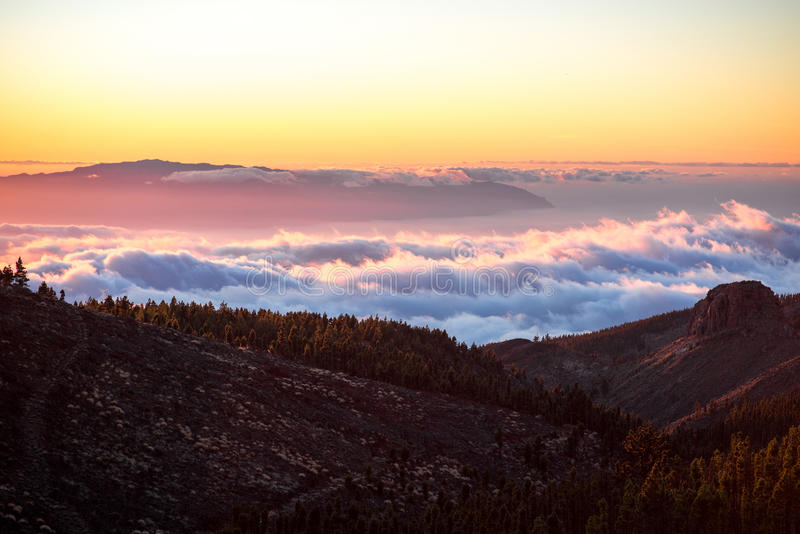 Beautiful landscape view on the sunset. Beautiful landscape view on La Gomera island from Tenerife island above the clouds on the sunset stock images