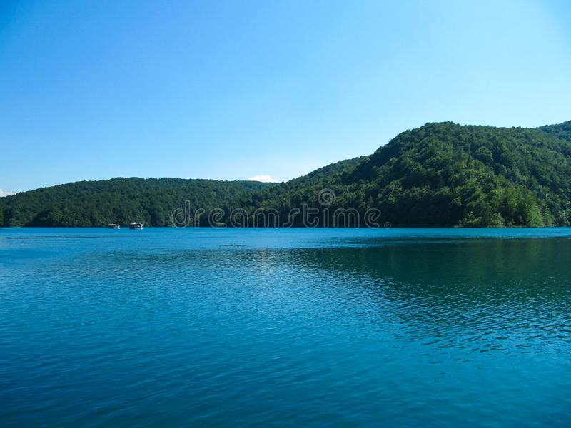 Beautiful landscape with views of the two River boat floating on the lake in the national Park Plitvice lakes, Croatia stock image