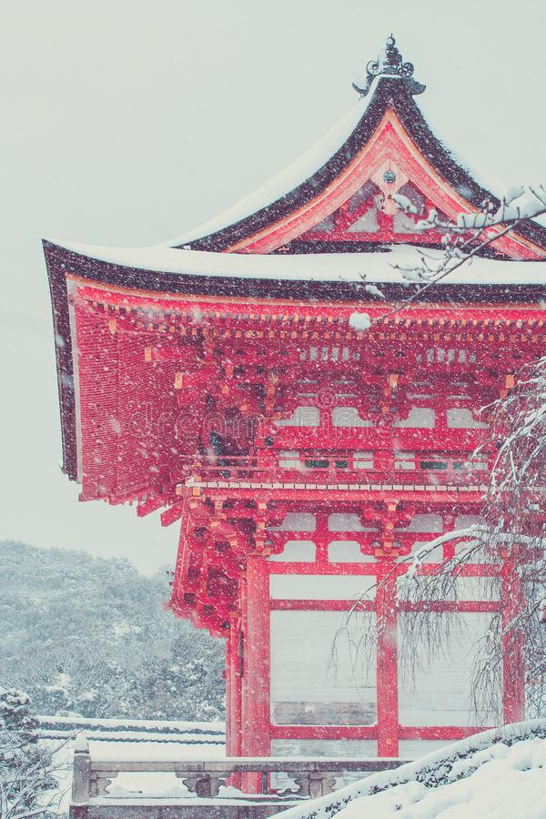 Beautiful landscape in winter seasonal : Red Japanese pagoda covered with white snow in Kiyomizu-dera Temple, Kyoto. Beautiful landscape in winter seasonal stock images
