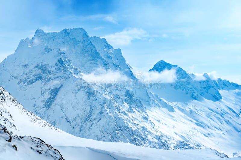 Beautiful landscape winter snow covered of Dombaj mountain peaks stock photos