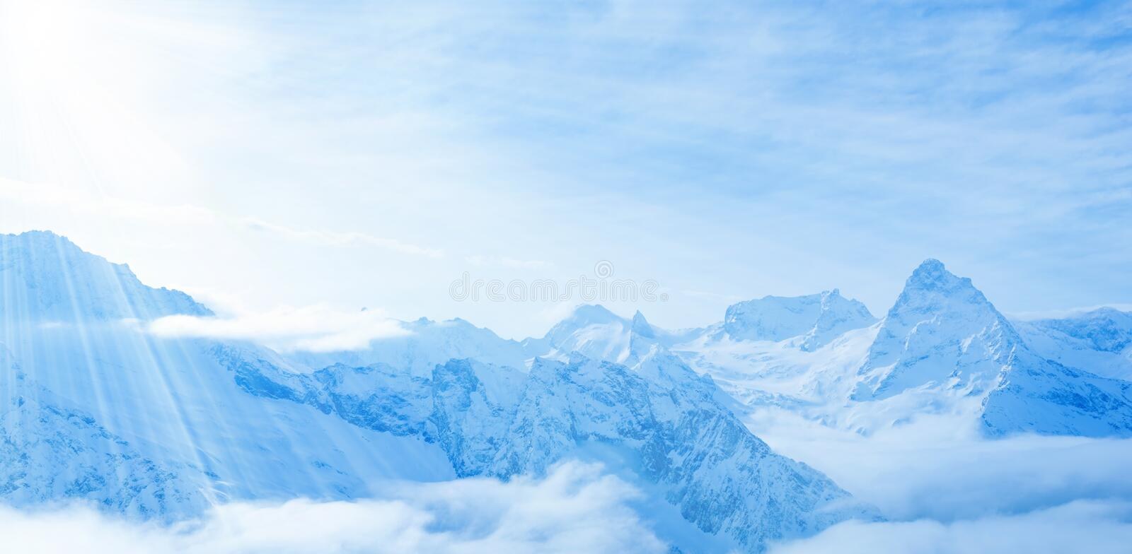 beautiful landscape winter snow covered peaks of Caucasus mountain, Dombaj with clouds and blue sky, close up stock photos