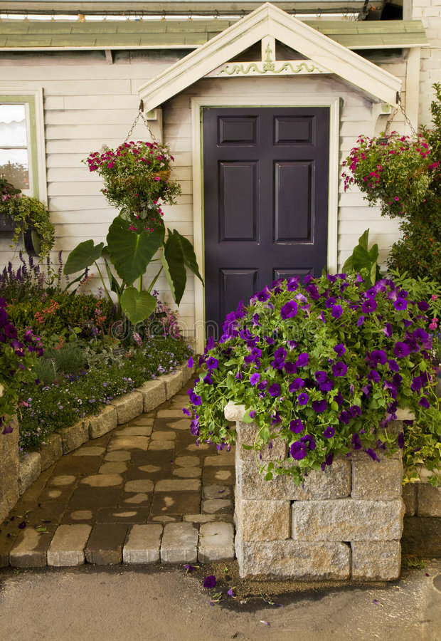 Beautiful Landscaping Outside an Old House. Photo of Beautiful Landscaping Outside an Old House stock photos