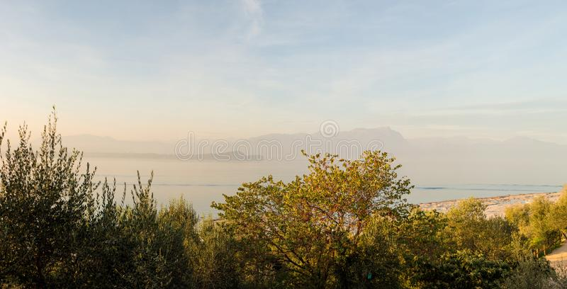 Beautiful lanscape with trees and Alps on background, Garda lake, Sirmione, Italy. Beautiful lanscape with trees and Alps on background. Garda lake, Sirmione stock image