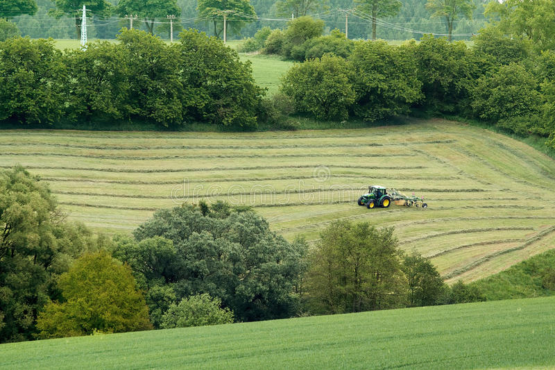Beautiful lansdscape with Haymaking. In Czech Republic royalty free stock photos