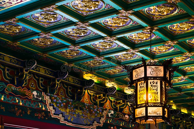 Beautiful lantern hang on Beautiful Chinese pattern ceiling at Chinese temple name Wat Borom stock images