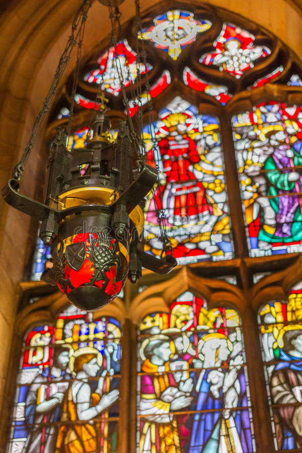 Beautiful Lantern and stained glass window inside St Giles Cathedral stock photography