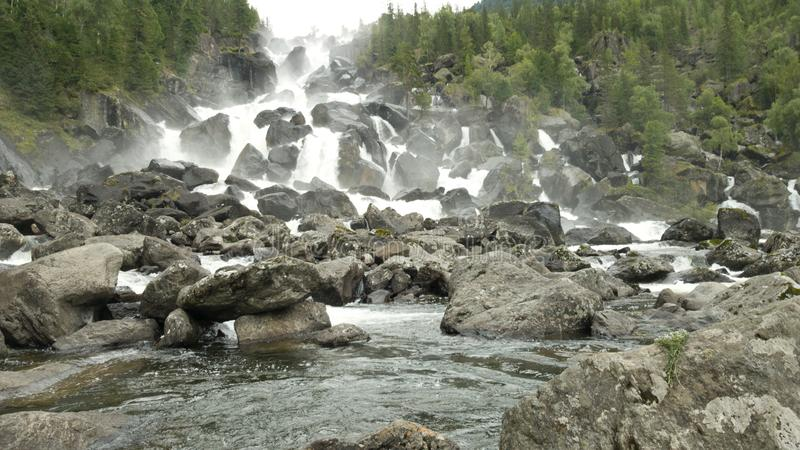 Beautiful and large cascade waterfall in the Altai Republic in Russia. The Uchar waterfall in the summer stock photo