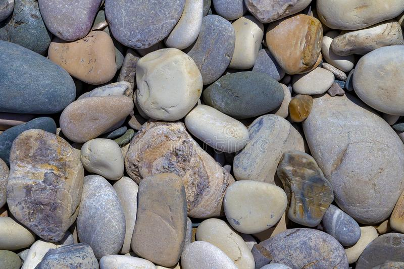 Beautiful large multi-colored pebbles.background of stones royalty free stock photos