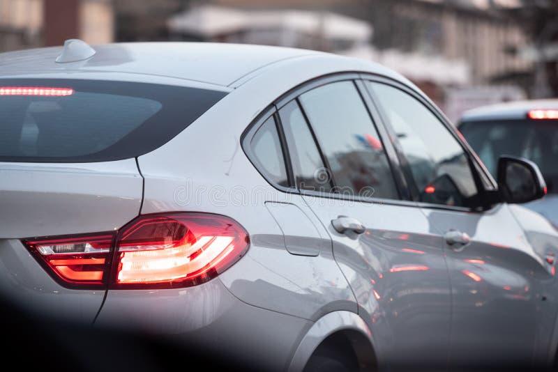 Beautiful white luxury car stuck in traffic stock image
