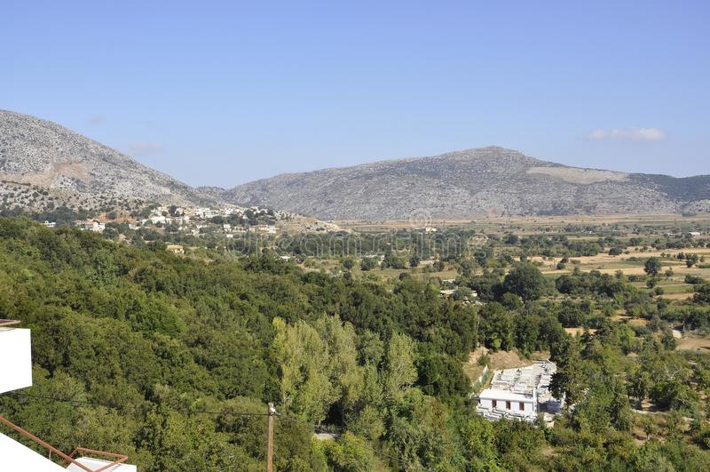 Lassithi Plateau panorama in Crete island of Greece. Beautiful Lassithi Plateau landscape in Crete island of Greece on august 2017 stock images