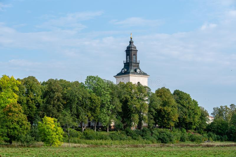 Tower of an old white church royalty free stock photography