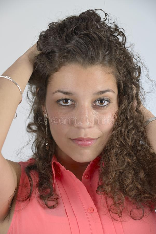 Beautiful latin girl with curly hair royalty free stock photos