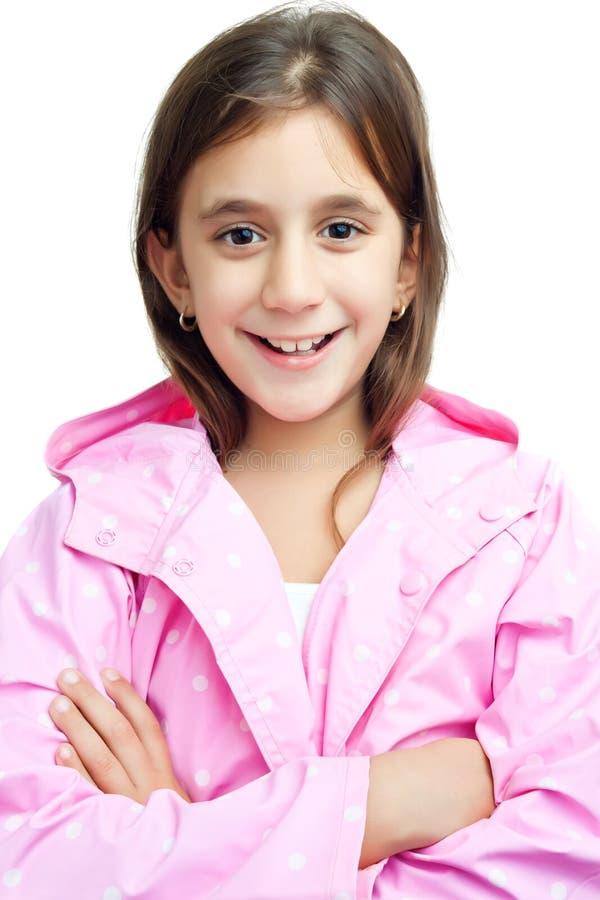 beautiful latin girl wearing a pink raincoat royalty free stock images