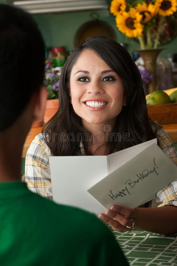 Beautiful Latina Woman with Birthday Card stock images