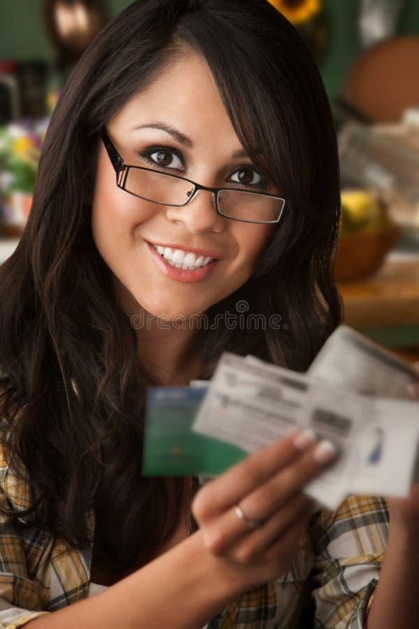Beautiful Latina Woman with Coupons stock image
