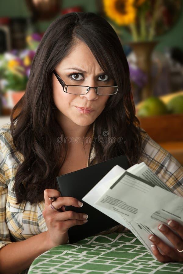 Beautiful Latina Woman with Many Bills royalty free stock photography
