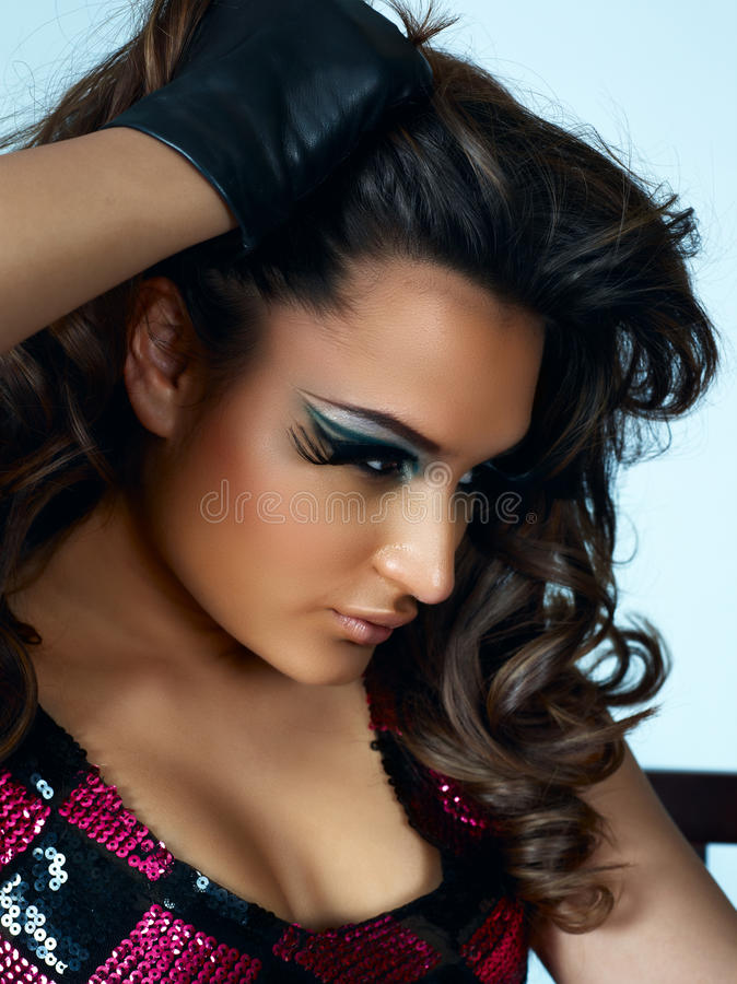 Beautiful latino woman with long curly hair stock photo
