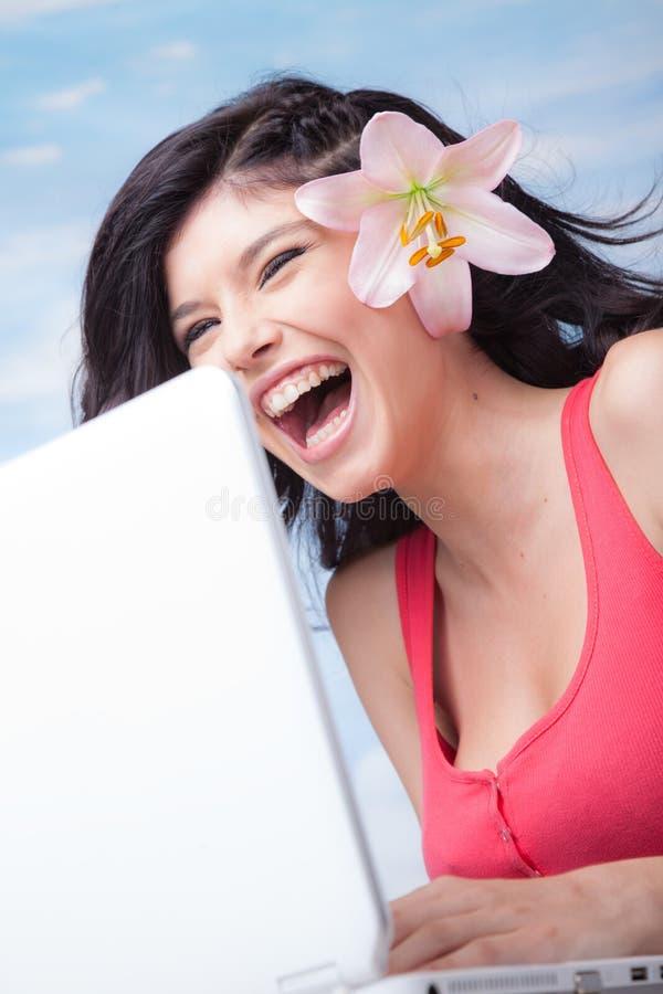 Laughing Girl Laptop Lilium stock image