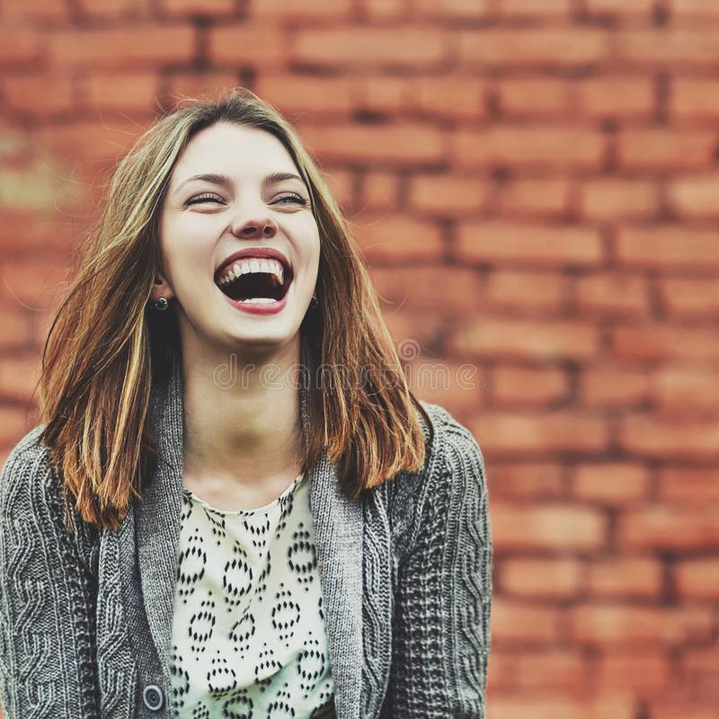 Beautiful laughing girl outdoor portrait royalty free stock photography