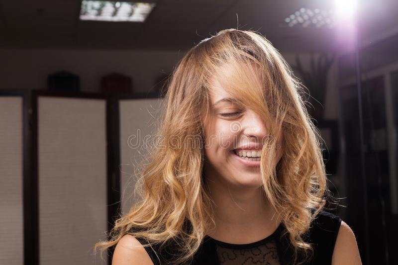 Beautiful laughing young model with hair on a face stock photos