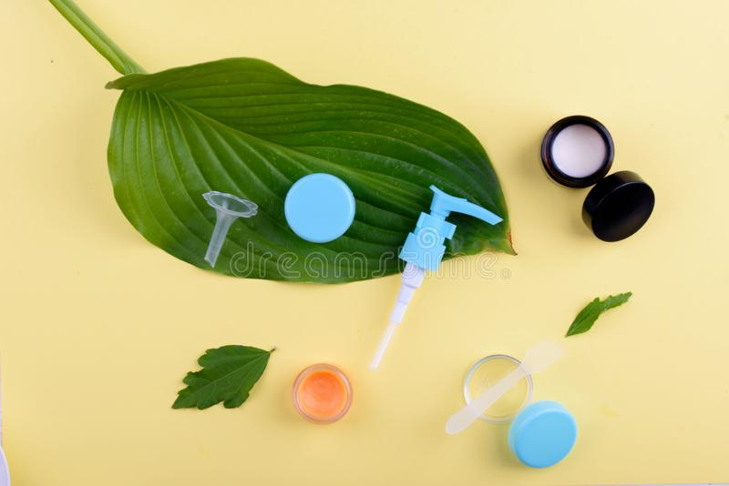 Beautiful layout of cosmetic products on a yellow background. Natural cosmetics for face and body royalty free stock photo