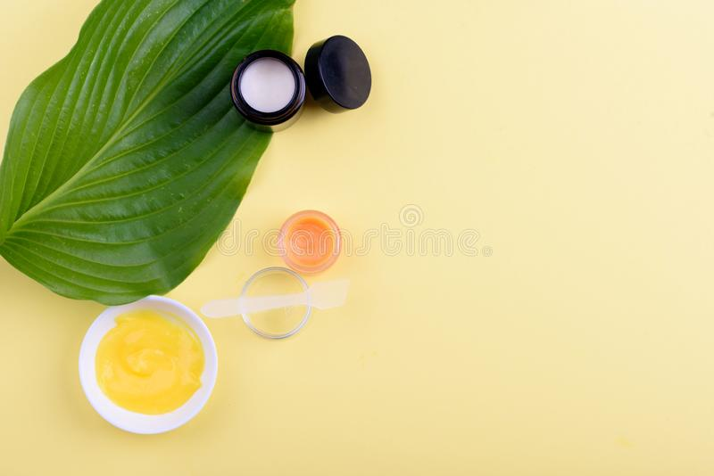 Beautiful layout of cosmetic products on a yellow background. Natural cosmetics for face and body royalty free stock photos