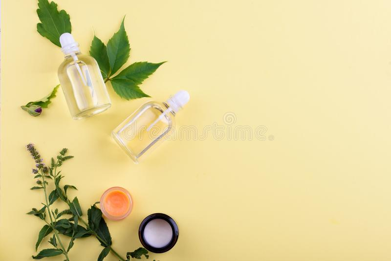 Beautiful layout of cosmetic products on a yellow background. Natural cosmetics for face and body stock photography