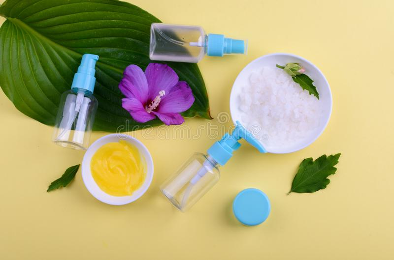 Beautiful layout of cosmetic products on a yellow background. Natural cosmetics for face and body stock image