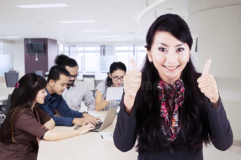 Beautiful leader with her employees in the office royalty free stock image