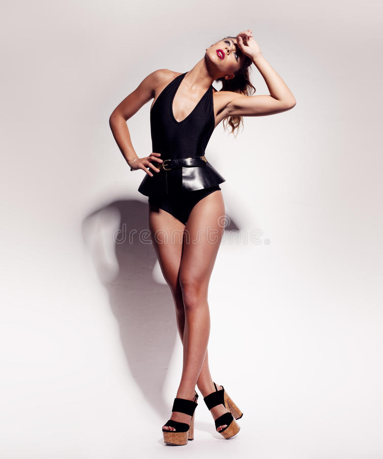 Beautiful leggy woman in a leotard royalty free stock images