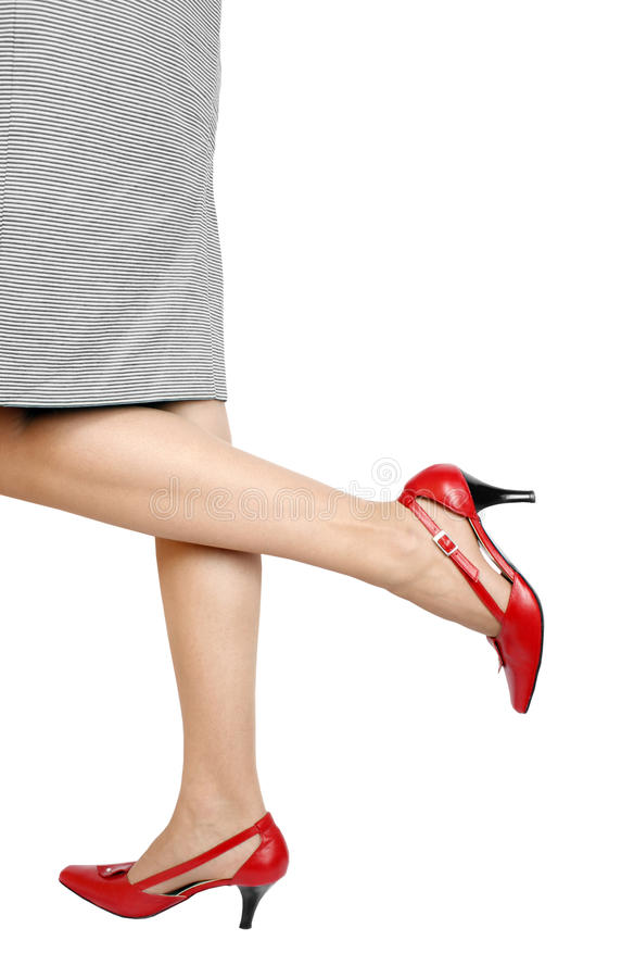 Beautiful legs. And red high heels shoes stock photography