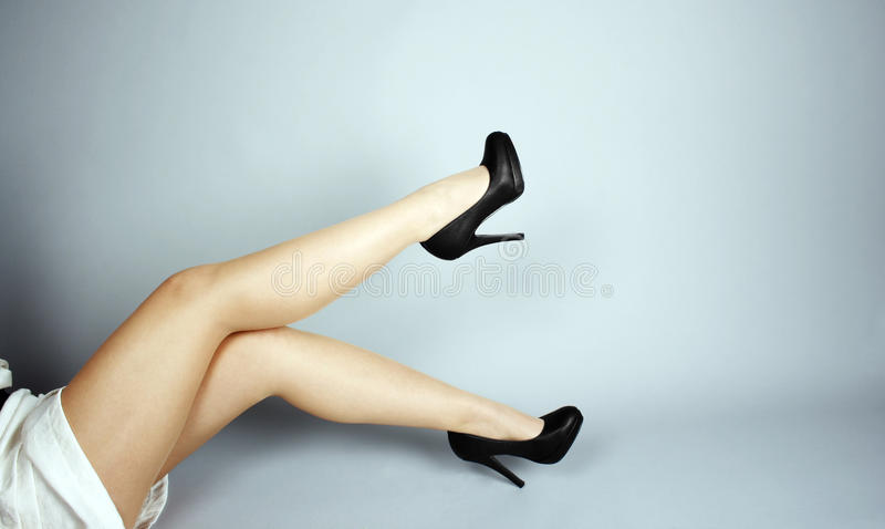 Beautiful legs. And high hills shoes stock photography