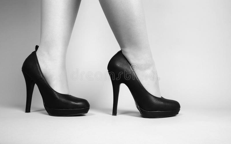 Beautiful legs. And high hills shoes stock photo